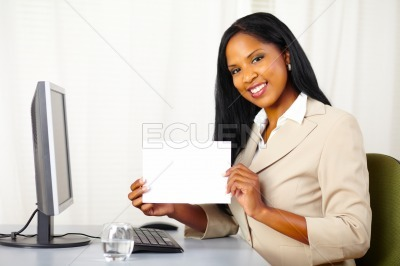 Executive woman showing a white card