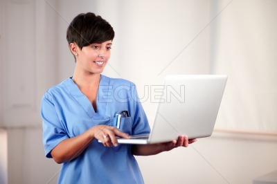Female doctor working on her laptop