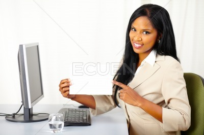 Friendly executive lady showing a white card