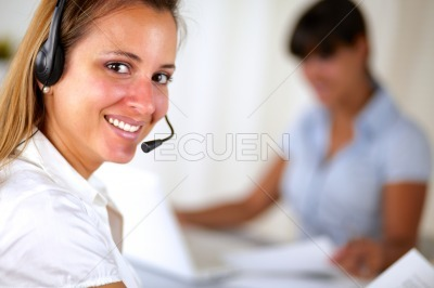 Friendly secretary telephone operator at office