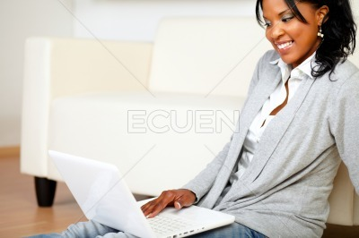 Friendly woman using her laptop