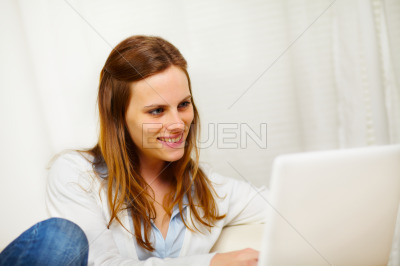 Friendly woman working on laptop