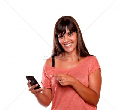 Friendly young woman pointing her cellphone