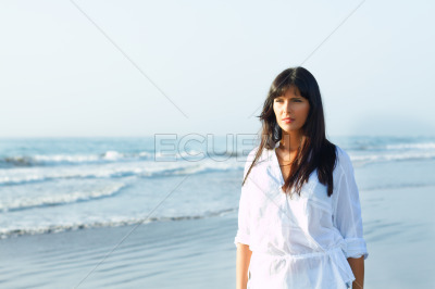 Girl walking along the seashore