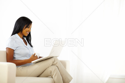 Gorgeous young woman working on laptop
