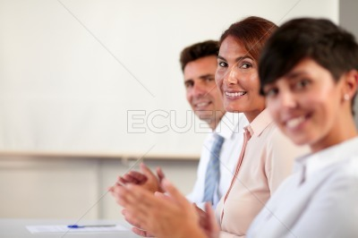 Group of business people smiling at you