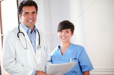 Handsome doctor and beautiful nurse smiling