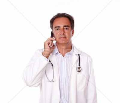 Handsome doctor talking on his cellphone