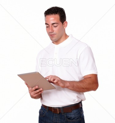 Handsome young man using his tablet pc