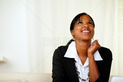 Happy afro-american woman looking up