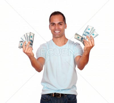 Happy and excited latin man with cash money