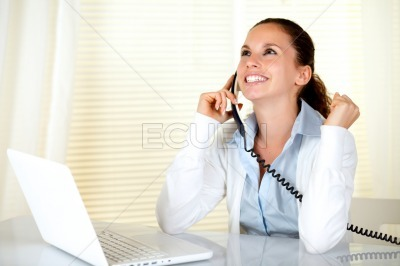 Happy and excited young woman speaking on phone