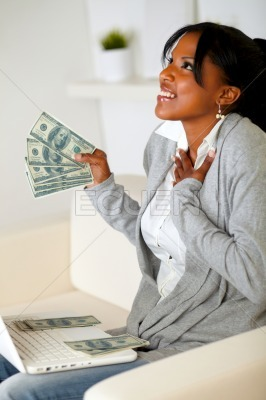 Happy woman holding plenty of cash money
