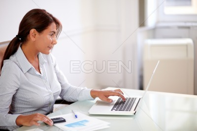 Hispanic businesswoman working with her laptop