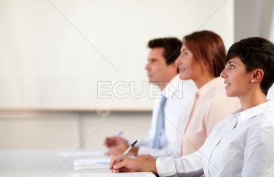 Hispanic colleagues listening to a conference