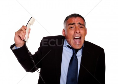 Hispanic senior businessman screaming with a phone