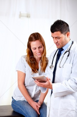 Latin doctor and a female looking to tablet PC