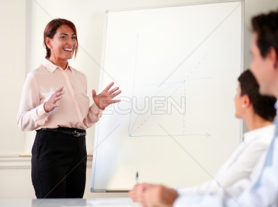 Lovely smiling businesswoman giving a presentation