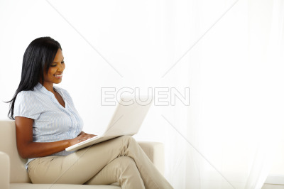 Lovely young woman working on laptop