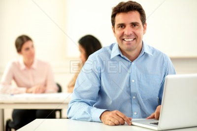 Male hispanic consultant smiling at you