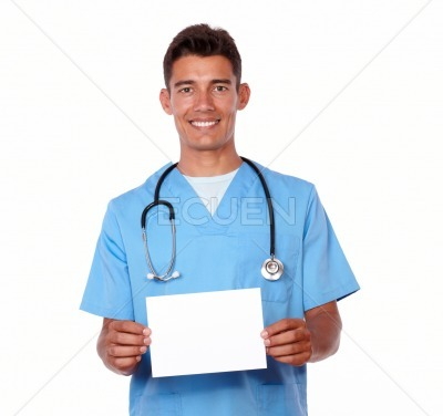 Male nurse with stethoscope holding a blank card