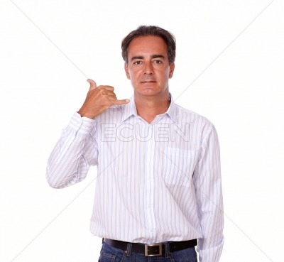 Mature male standing with call gesture