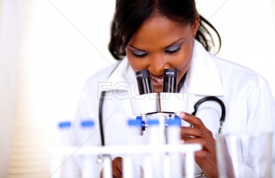 Medical doctor woman working with a microscope