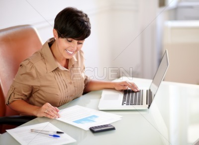 Office woman working with her laptop and documents