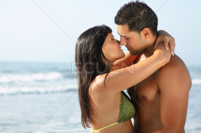 Portrait of a loving couple kissing and embracing