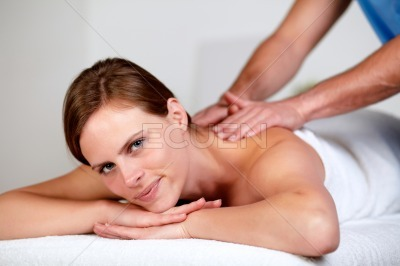 Pretty blonde woman relaxing at a spa