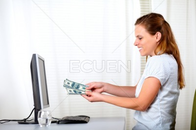Pretty blonde woman with money at the office