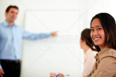 Pretty businesswoman smiling and looking at you