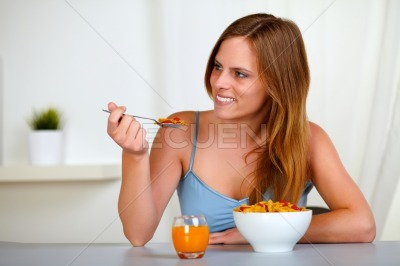Pretty lovely woman smiling and eating