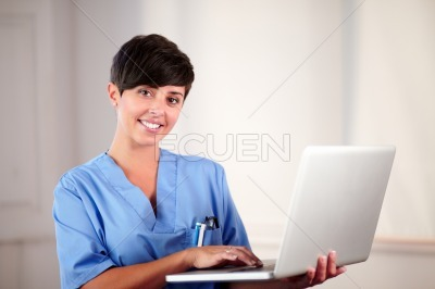 Pretty medical lady working on her laptop