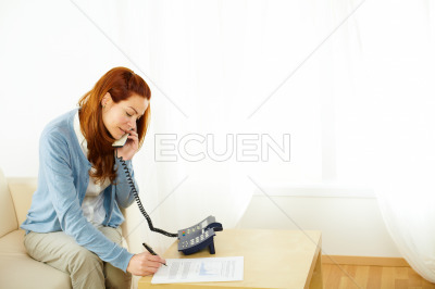 Pretty woman working and talking at phone