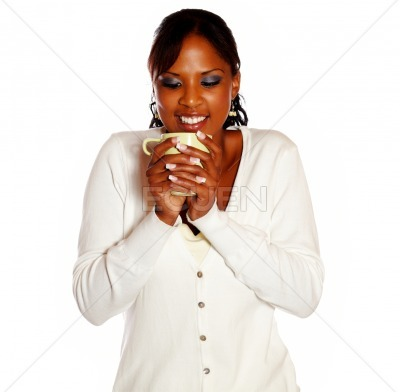 Pretty young female drinking a mug of coffee