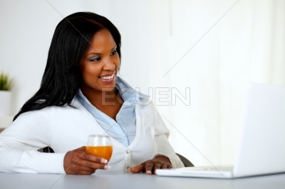 Pretty young girl having fun on laptop