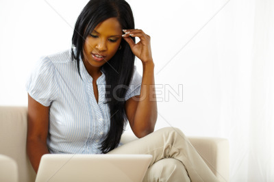 Pretty young woman browsing on laptop