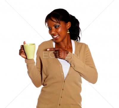 Pretty young woman pointing a mug