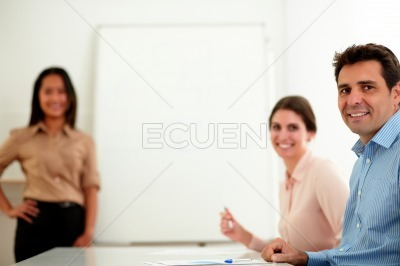 Professional coworker group smiling at you