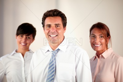 Professional enterpreneur group smiling at you