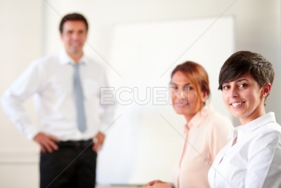 Professional executive group smiling at you