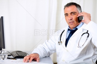 Professional friendly senior doctor