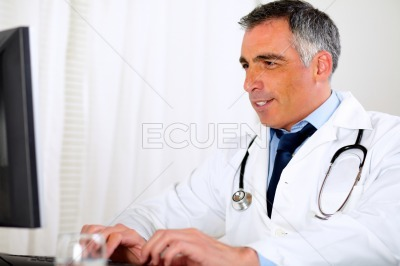 Professional latin doctor using a computer