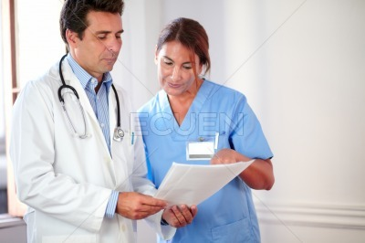 Professional medical team working on documents