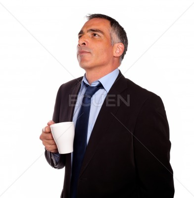 Reflective business man with a white mug