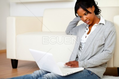 Relaxed black woman browsing the Internet