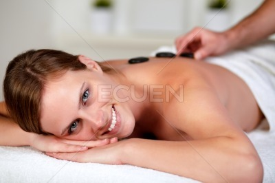 Relaxed woman receiving a massage at spa