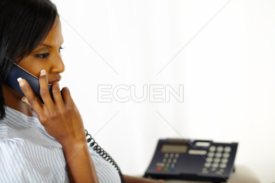 Relaxed young lady talking on phone