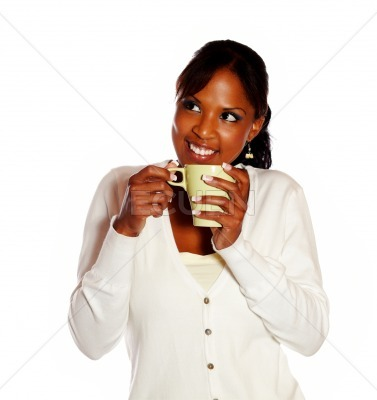 Relaxed young woman having coffee